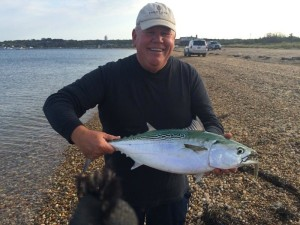 ALBIE DARNED: Verizon Charlie and his little tunny in Fort Pond Bay