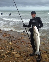 MONTAUK ROCKS: Matt Broderick took down this bass while perched high on a boulder in the surf