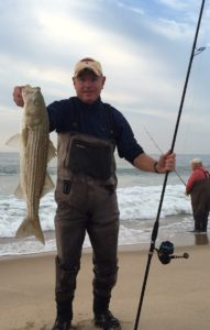 """HERE!"" Billy saw the bait in the wash and in a flash he had this 28-inch striper on the beach"