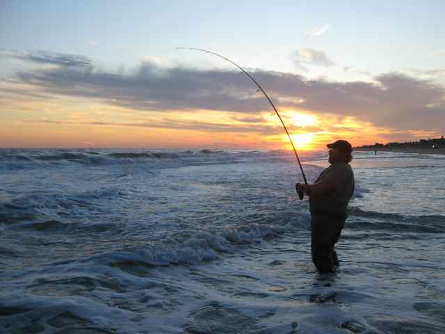 Sunset at Napeague: Sam Doughty leans back on a sunset striper